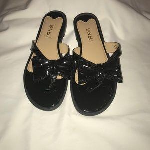 Black Patent thong sandals.